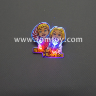 flashing cartoon couple badges tm02331